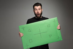 The surprised man as businessman with green panel Stock Photos