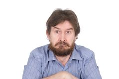 The surprised man with a beard. Isolated on white background Stock Image