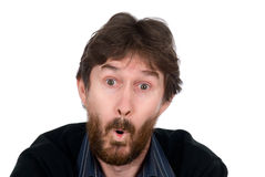 The surprised man with a beard. Isolated on white background Stock Images