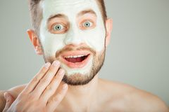 Surprised man with beauty mask, skin care.  Royalty Free Stock Photo