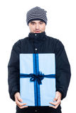 Surprised man with big present Royalty Free Stock Image