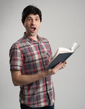 Surprised man with book Stock Photos