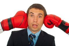 Surprised man between boxing gloves Stock Photography