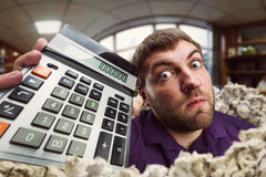 Surprised man with calculator Stock Image