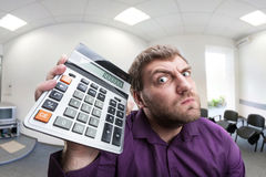 Surprised man with calculator Stock Photos