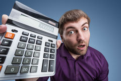 Surprised man with calculator Stock Photo