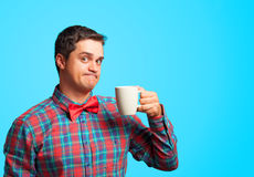 Surprised man with cup Royalty Free Stock Photography
