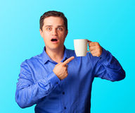 Surprised man with cup Royalty Free Stock Photos