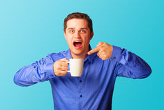 Surprised man with cup Stock Images