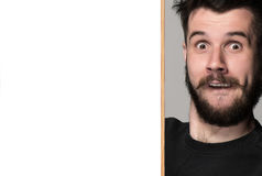 The surprised man and empty blank over gray background Royalty Free Stock Image