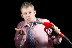Surprised man with fuel dispenser Stock Photo