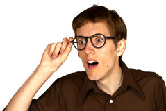 Surprised Man with Glasses. Three quarter view of man with glasses looking surprised and disbelieving, isolated on white background Stock Photography