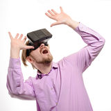 Surprised man with glasses of virtual reality in lilac shirt Royalty Free Stock Photography
