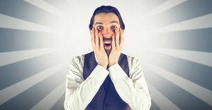 Surprised man with hands on cheeks against bright background Royalty Free Stock Images