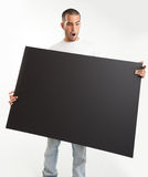 Surprised Man holding blackboard Stock Photo