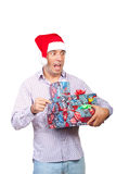 Surprised man holding Christmas gifts Royalty Free Stock Photo