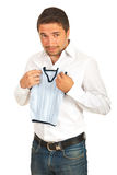 Surprised man holding shrunk vest Stock Photo