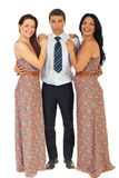 Surprised man holding two laughing women. In same dress isolate don white background Stock Photo