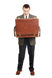 Surprised man holds an open suitcase Royalty Free Stock Photos