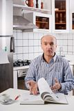 Surprised man in the kitchen. Stock Photo