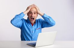 Surprised man with laptop computer Royalty Free Stock Image