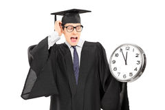 Surprised man looking at a big wall clock Stock Images
