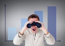 Surprised man looking through binoculars against grey background with infographics. Digital composite of Surprised man looking through binoculars against grey Royalty Free Stock Photography