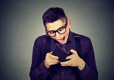 Surprised man looking at his wallet royalty free stock photo