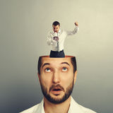 Surprised man looking up at angry man Royalty Free Stock Image