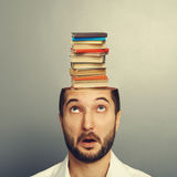 Surprised man looking up at books Royalty Free Stock Photography