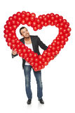 Surprised man looking up through the heart shape Stock Photos