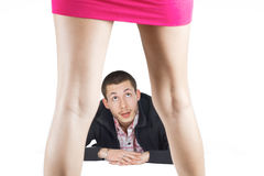 Surprised man looks at an attractive girl Stock Photography