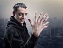 Surprised man looks at his strange hand. Surprised man looks at his palm with seven fingers Stock Images