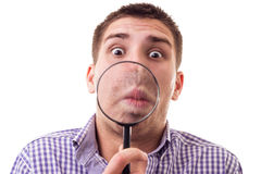 Surprised man through Magnifying glass Stock Image