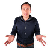 Surprised  man makes  helpless gesture. On white Royalty Free Stock Photo