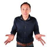 Surprised man makes helpless gesture royalty free stock photo
