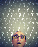 Surprised man with many questions Stock Photography