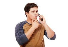 Surprised man with mobile phone. Royalty Free Stock Photography