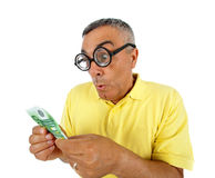 Surprised man with money and WOW expression. Stock Photo