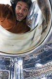Surprised man open a washer Stock Image
