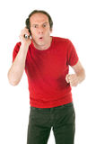 Surprised man phoning Royalty Free Stock Photography
