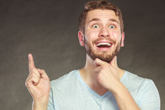 Surprised man pointing at empty blank copy space. Royalty Free Stock Photo
