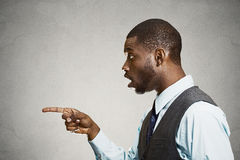 Surprised man pointing with finger at someone, something Royalty Free Stock Photos