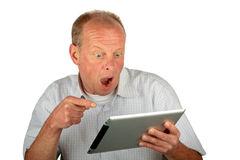 Surprised man pointing at his tablet computer Stock Photography