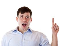 Surprised man pointing and looking at copyspace Royalty Free Stock Image
