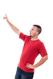 Surprised man pointing up Stock Photography