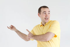Surprised man points out off somewhere Royalty Free Stock Images