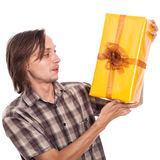 Surprised man with present Stock Photos