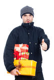 Surprised man with presents thumbs up Stock Photography