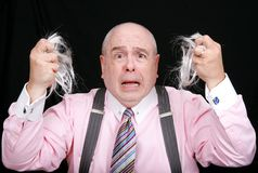 Surprised man pulled his hair out Stock Image